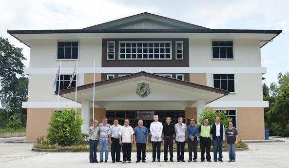 Sandakan pastoral leaders pose in front of the pastoral centre with the apostolic nuncio.