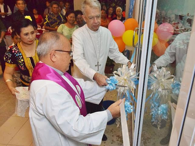 Bishop Julius and Abp Marino cut the ribbon to open the centre.