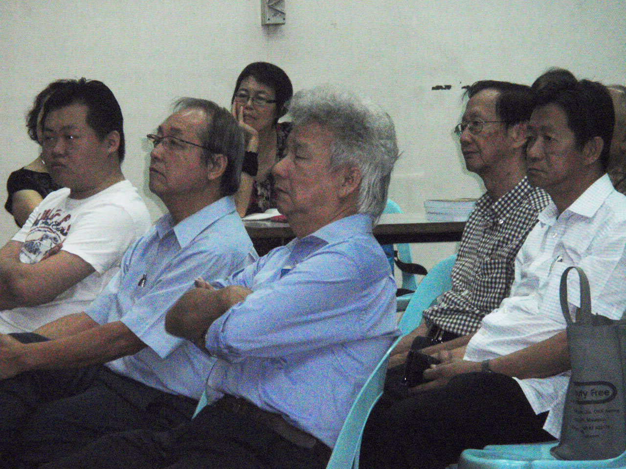 A section of the participants listening intently to the speaker.